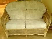 2 x Two Seater Cane Settee's c/w cream pastel cushons
